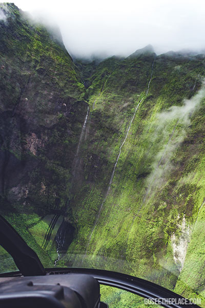 Kauai helicopter excursion. The view of waterfalls from inside the helicopter.