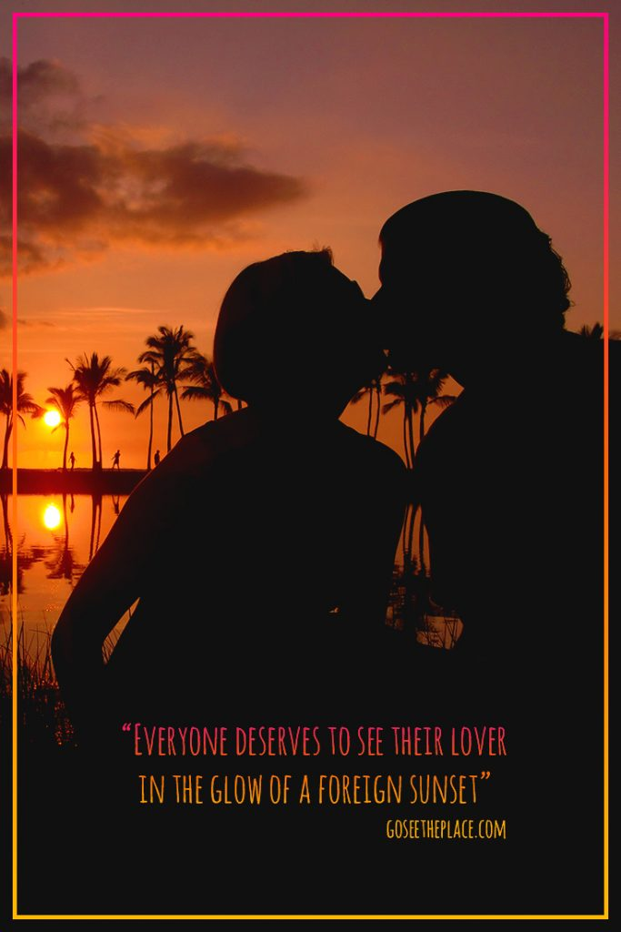 "Travel Quote: ""Everyone deserves to see their Lover in the glow of a Foreign Sunset."" Overlaid on an image of a sunset and palm trees with a silhouette of Megan and RJ kissing."