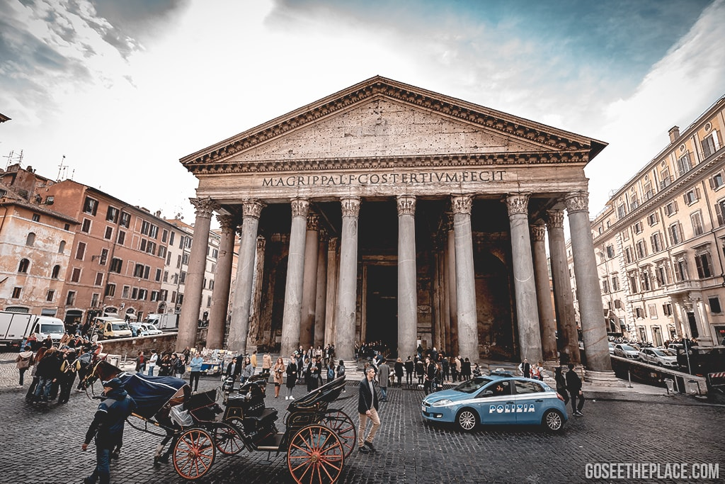 Standing in front of the Pantheon in the Piazza della Rotonda in Rome, Italy near a coffee house.